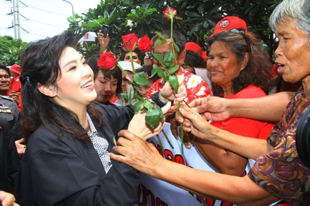 Prime Minister Yingluck Shinawatra is mobbed by her devoted fans in Laem Chabang.