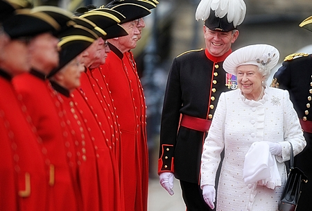 Britain's Queen Elizabeth II, right, arrives at Chelsea Pier in London, before boarding the royal barge to participate in the Diamond Jubilee River Pageant, Sunday, June 3. More than 1,000 boats sailed down the River Thames Sunday in a flotilla tribute to Queen Elizabeth II's 60 years on the throne that organizers are calling the biggest pageant on the river for 350 years. (AP Photo/Bethany Clarke, Pool)