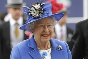 Britain's Queen Elizabeth II arrives for the Epsom Derby at Epsom race course, southern England at the start of a four-day Diamond Jubilee celebration to mark the 60th anniversary of the Queen's accession to the throne Saturday, June 2. (AP Photo/Sang Tan)