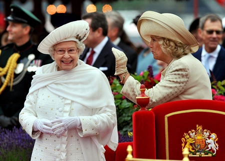 Britain's Queen Elizabeth II, left, and Camilla, Duchess of Cornwall, speak while on the royal barge during the Diamond Jubilee Pageant on the River Thames in London, Sunday, June 3. (AP Photo/John Stillwell, Pool)