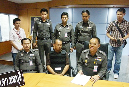 "Police have arrested Thanuu ""Nu Makhamkhu"" Klanthut (seated, center), the last remaining suspect in the 2008 killing of a car care executive."