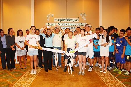 Dusit Thani Pattaya General Manager Chatchawal Supachayanont cuts the ribbon to launch No Tobacco Day.
