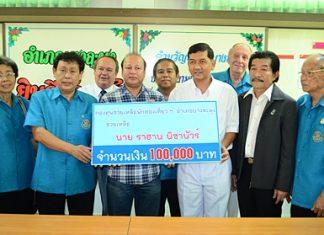 Jahangir Hossain (center), head of Pattaya's Bangladesh community, representing 3 recent Bangladeshi crime victims, accepts aid from Banglamung District Chief Chawalit Saeng-Uthai.