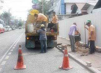 City workers repair a portion of sidewalk on Second Road in North Pattaya.