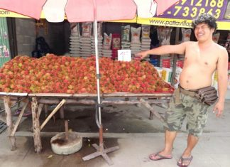 Rambutan vendor Thew Janthakhram says he's doing well enough that he'll even give away extra fruit with big purchases.