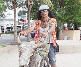 Sunya Sompu turns heads when riding around town on his water buffalo bike.