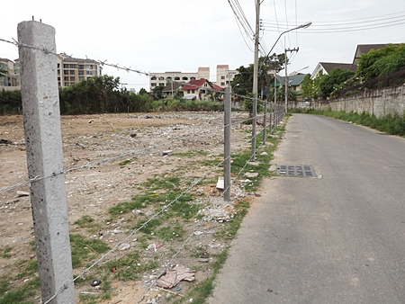 After the city finally cleaned up this area, which had been used as a free-for-all garbage dump for over a year, the owner put up a barbed wire fence to make sure it doesn't happen again.
