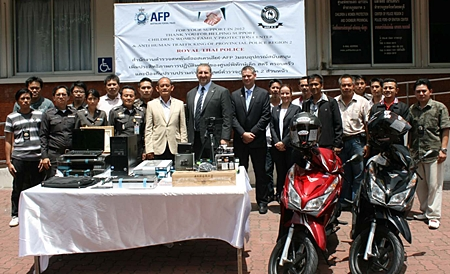 Australian law enforcement officials donate 300,000 baht in equipment to Thailand Region 2 police.