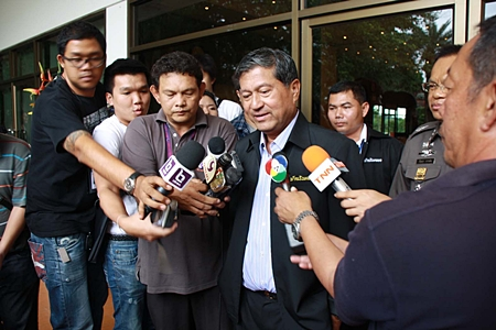 Interior Minister Chalerm Yubamrung meets the press outside a June 18 meeting at Nong Nooch Tropical Garden.