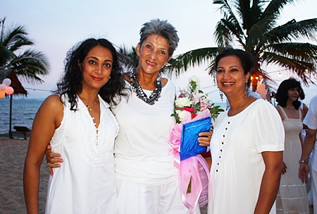 Anou McPherson (left) and Rachna Rao (right) say happy birthday to Pat Burbridge.