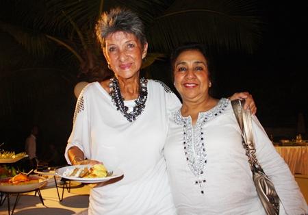 Pat Burbridge and Rani Khanijou enjoy some birthday cake.