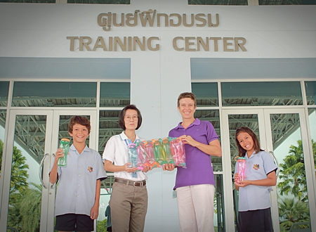 Choawanee Panpruk, Social Enterprise Manager from sponsors PTTCG, gave 300 water bottles to Miss Lucy for GIS students to use at the Games.