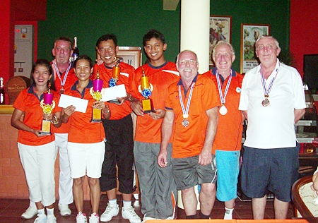 The winners, far left, pose with the runners-up and losing semi-finalists at the Coco Club, Sunday, June 17.