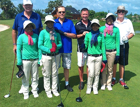 From left: Jim Smith, Clyde Smith, Martin Kingswood & Bill Rogers with their caddies at Angkor Golf Resort.