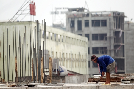 A worker is seen at a construction site in Hanoi, Vietnam. (EPA/Luong Thai Linh)