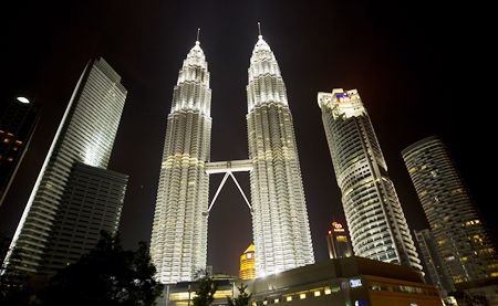 Malaysia's landmark Petronas Twin Towers are shown in the capital Kuala Lumpur.  The nation's major property developers have been buying up large land parcels despite signs of a cooling real estate sector. EPA/Ahmad Yusni
