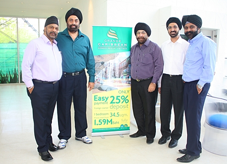 Directors of Blue Sky Developer Co. Ltd., from left, Tripatpal Singh Sachdev, Manmohan Singh Chawla, Popinder Singh Khanijou, Chawarin Sakulsacha, and Narinder Singh Gulati pose for a photo at the official opening of the project, June 16.