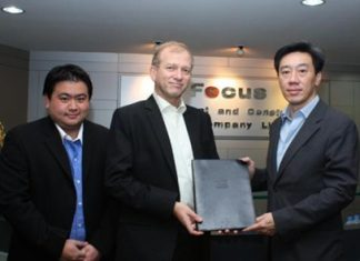 Anucha Sihanatkathakul, right, Executive Chairman of Focus Development and Construction Public Company Limited, and Monchai Orawongpaisan, left, Associate Director of Project Sales & Marketing, stand with Simon Landy, centre, Executive Chairman of Colliers International Thailand at the Alma Link Building after signing the agreement for Colliers to act as sole selling agents for the Focus@Ploenchit development. The project value is approximately THB 800 million and is expected to be launched in Q3 this year.
