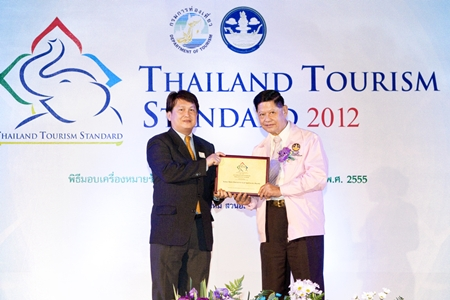 Chumpol Silapa-archa (right), Minister of Tourism and Sports presents the 2012 Thailand Tourism Standard Award to Kulasate Howongratana, director of the Kasemkij Hotels Group. The group received the award recently for their outstanding long stay properties, namely the Cape Racha Hotel Sriracha and the Kameo House, Rayong.