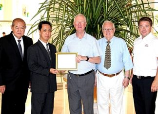Representatives of the Rotary Club of Jomtien-Pattaya, headed by Philip Wall Morris, Service Projects Chairman, Brendan Kelly and Ronny Heltne presented a Plaque of Appreciation to Neoh Kean Boon, resident manager and Waran Chalermrithichai, Director of Administration of the Dusit Thani Pattaya in gratitude for the hotel's kind sponsorship and generous support of the 2011 Rotary Charity Cross Bay Swim recently. Funds raised from this event helped to provide clean drinking water to thousands of children and residents of the outlying communities in Thailand.