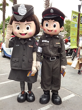 Pattaya's friendly police dolls entertain the crowd.