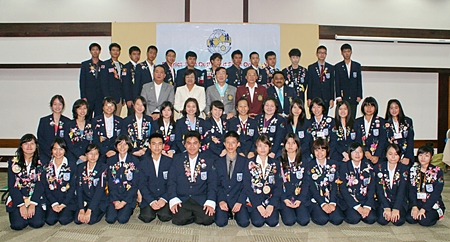 The Rotary Youth Exchange committee poses for a group photo with the outbound students.