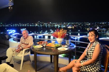 Dr. Iain and Pim enjoy the Pattaya Bay view.