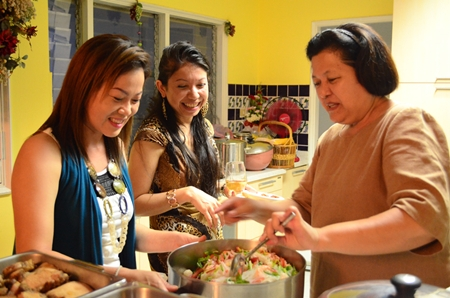 (L to R) Som, Pui and Alvi are having a great time preparing the Thai food.
