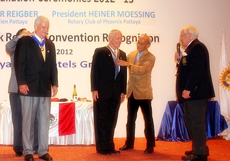 Heiner Moessing (right) receives his presidential medal, while his predecessor, Hubert Maier has his removed. On the far right is Brendan Kelly.