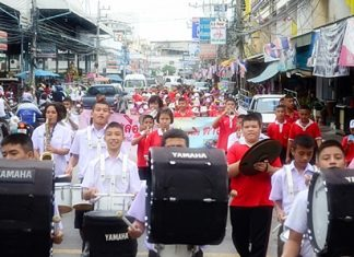 """Students lead public officials in a """"Fight Dengue Fever"""" parade last week through Naklua, spreading the message that it is dengue fever season and encouraging people to get rid of standing water around the house to reduce mosquito breading and mitigate the disease's spread."""