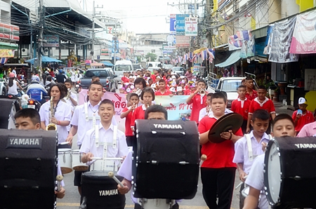 "Students lead public officials in a ""Fight Dengue Fever"" parade last week through Naklua, spreading the message that it is dengue fever season and encouraging people to get rid of standing water around the house to reduce mosquito breading and mitigate the disease's spread."