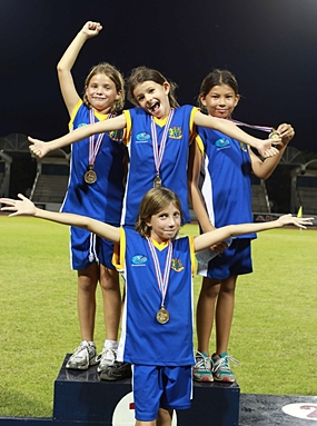 Year 4 girls Gold medal relay team (from left) Inez, Tessa, Jessica, and Golate (front).