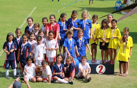 Football Champions (top left) Fiona, Jessica, Lily, Golate, Inez, and Tessa (front: sitting).