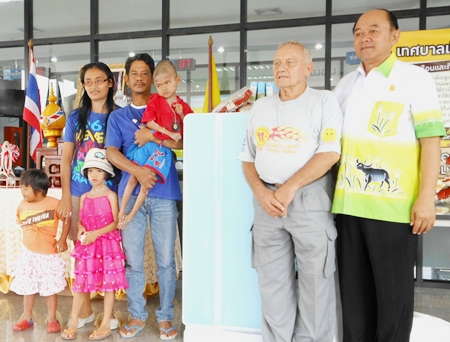 Somchai and his family with the disabled boy, Flook, who we provided with a side car for his motorcycle and now a refrigerator. Bernie and Nongprue Deputy Mayor Anek Patana-Ngam are standing to the right.