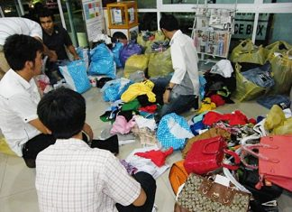 Copyright police sort through piles of counterfeit garments.