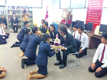 Students representatives present flowers to their teachers as a show of respect during the wai khru ceremony.