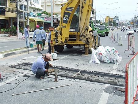 Workers from Pattaya's Engineering Department repair the sunken drain in Jomtien.