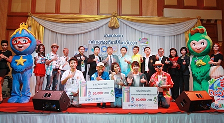 Officials, entertainers and mascots announce the upcoming Eastern Thailand tourism fair which will run Aug. 2-5 in Pattaya.