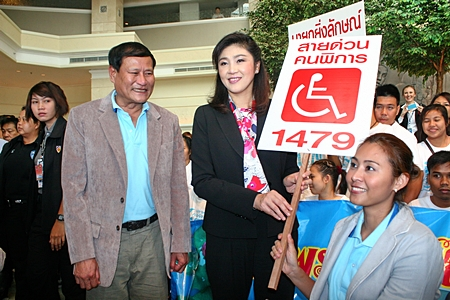 PM Yingluck Shinawatra meets with 150 handicapped students from the Redemptorist School for the Disabled.