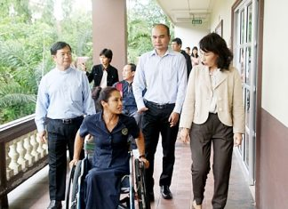 Dr. Picharn Jaiseri (left), president of the Redemptorist Center for Persons with Disabilities, leads Napa Setthakorn (right) and her the NEP committee on a tour of the foundation.