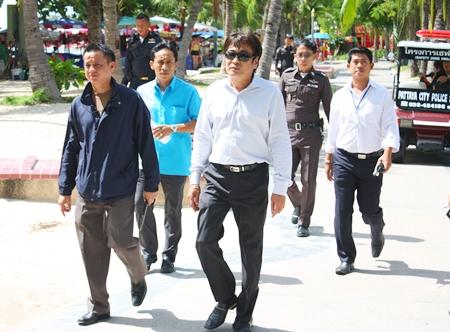 Pol. Lt. Col. Kiattisak Srathongoil (left), Deputy Superintendent of Pattaya Police Crime Suppression Division tours the beach with Deputy Mayor Ronakit Ekasingh, choosing six spots for construction of new police boxes.