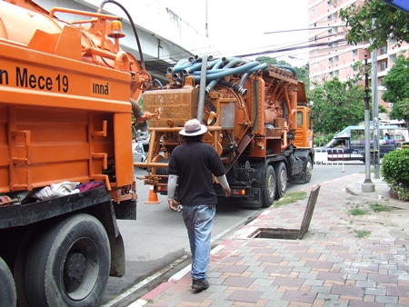 City workers move in heavy equipment to clean out the drains, hoping to prevent flooding during this year's rainy season.