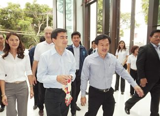 Former Prime Minister Abhisit Vejjajiva arrives at Cape Dara Resort in Naklua with Surat Mekarawarakul, CEO of Mike Group.