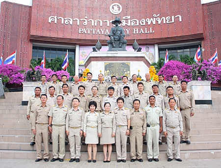 Pattaya's newly re-elected mayor, deputy mayors and city council members in front of the King Taksin Monument at City Hall.