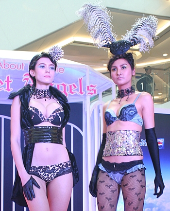 Professional models walk the runway in the latest lingerie fashions.