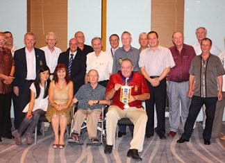 Members of the Rotary Club Taksin-Pattaya pose for one final group photo before merging with the Rotary Club of the Eastern Seaboard.