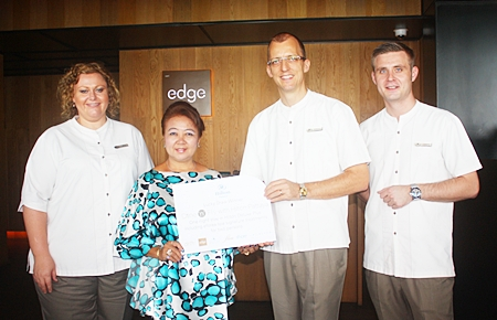 Preeyapat Chomjinda from Chonburi (2nd left), one of the lucky winners of Dine and Fly With Hilton Pattaya, receives her prize from Hilton Pattaya General Manager Harald Feurstein (2nd right).