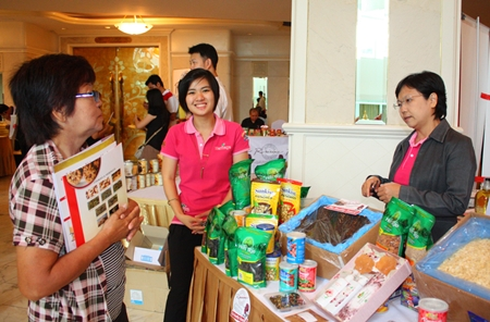 People at the seminar learn about various food products imported from the USA.
