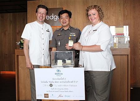 Michel Scheffers, Director of Operations, Hilton Pattaya, Pol. Maj. Aroon Promphan, Tourist Police Division Pattaya and Peta Ruiter, Director of Business Development, Hilton Pattaya draw the winning ticket.