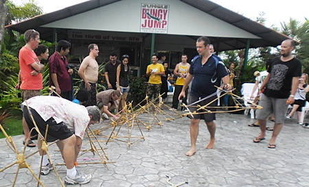 Nearly 40 Thai and foreign staff divided into six teams to compete in a sequence of mental and physical challenges.